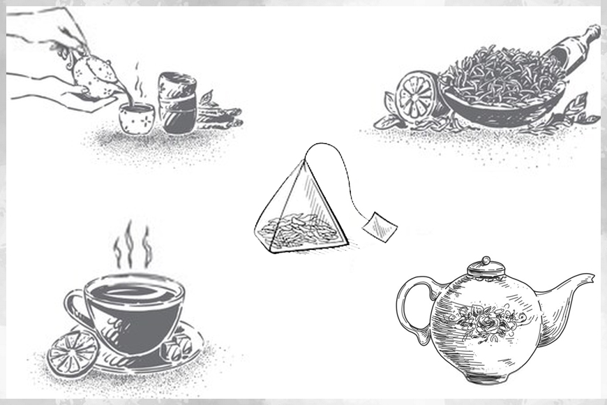 Tea pots, teabags, cup and leaves used for tea brewing